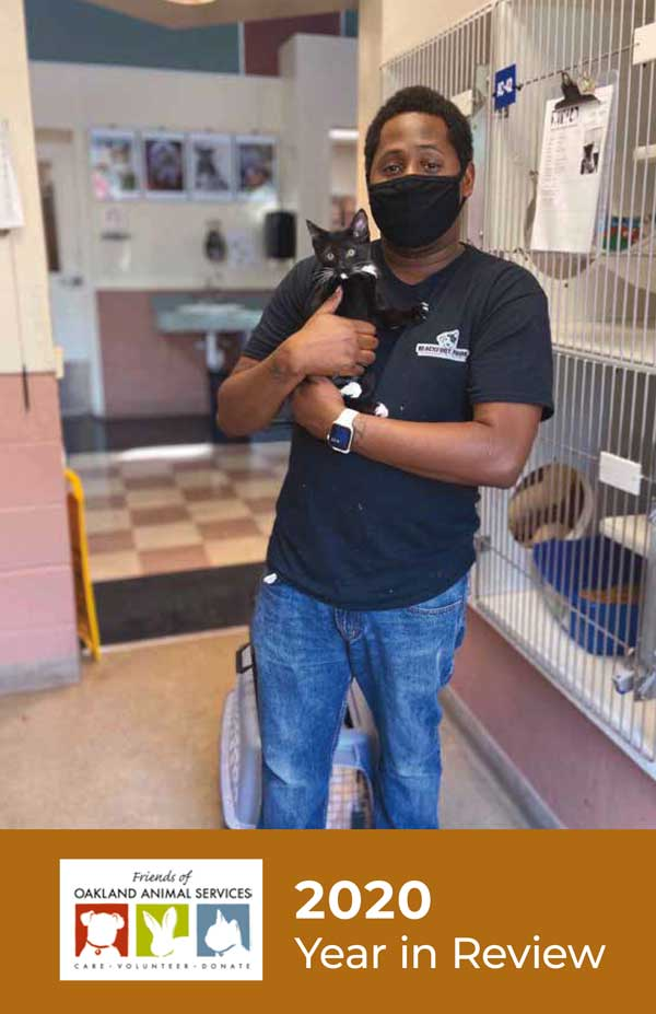 An image of the cover of the Year in Review features Donnell, shelter staff, holding a kitten at the shelter.